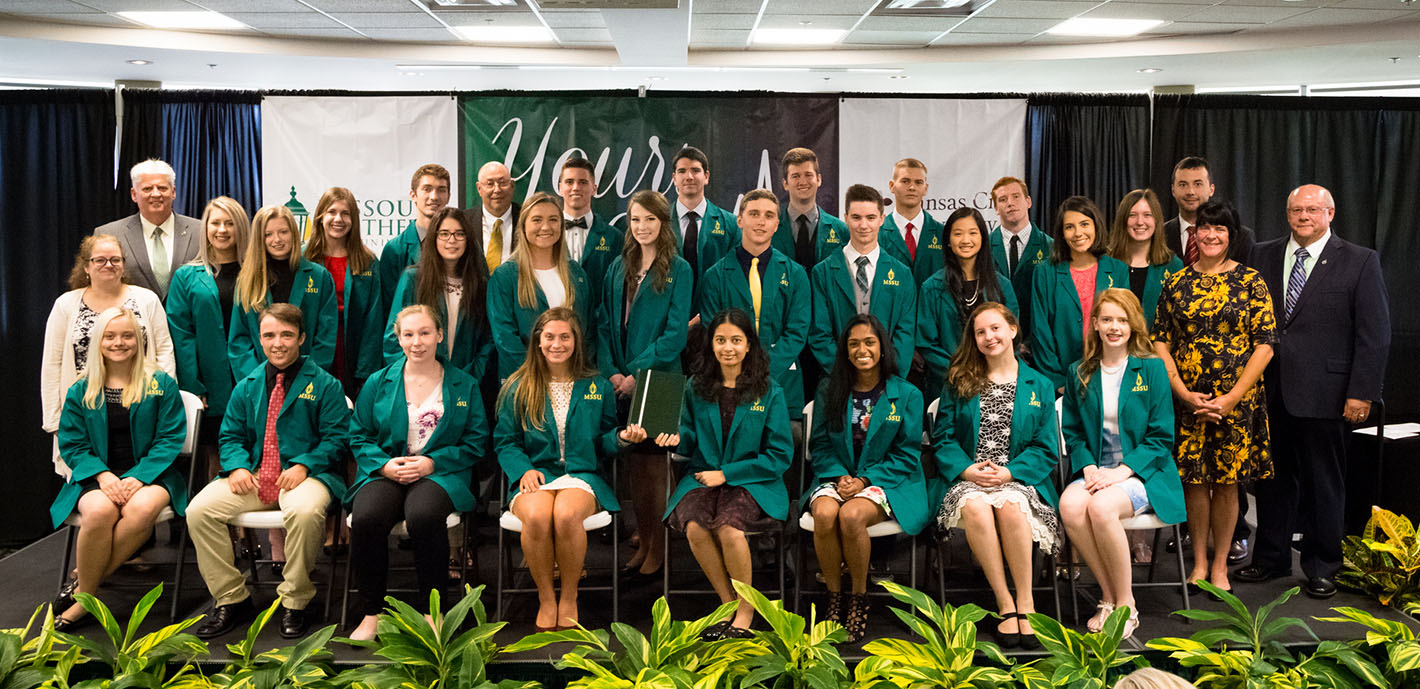 First Yours to Lose cohort receives green coats