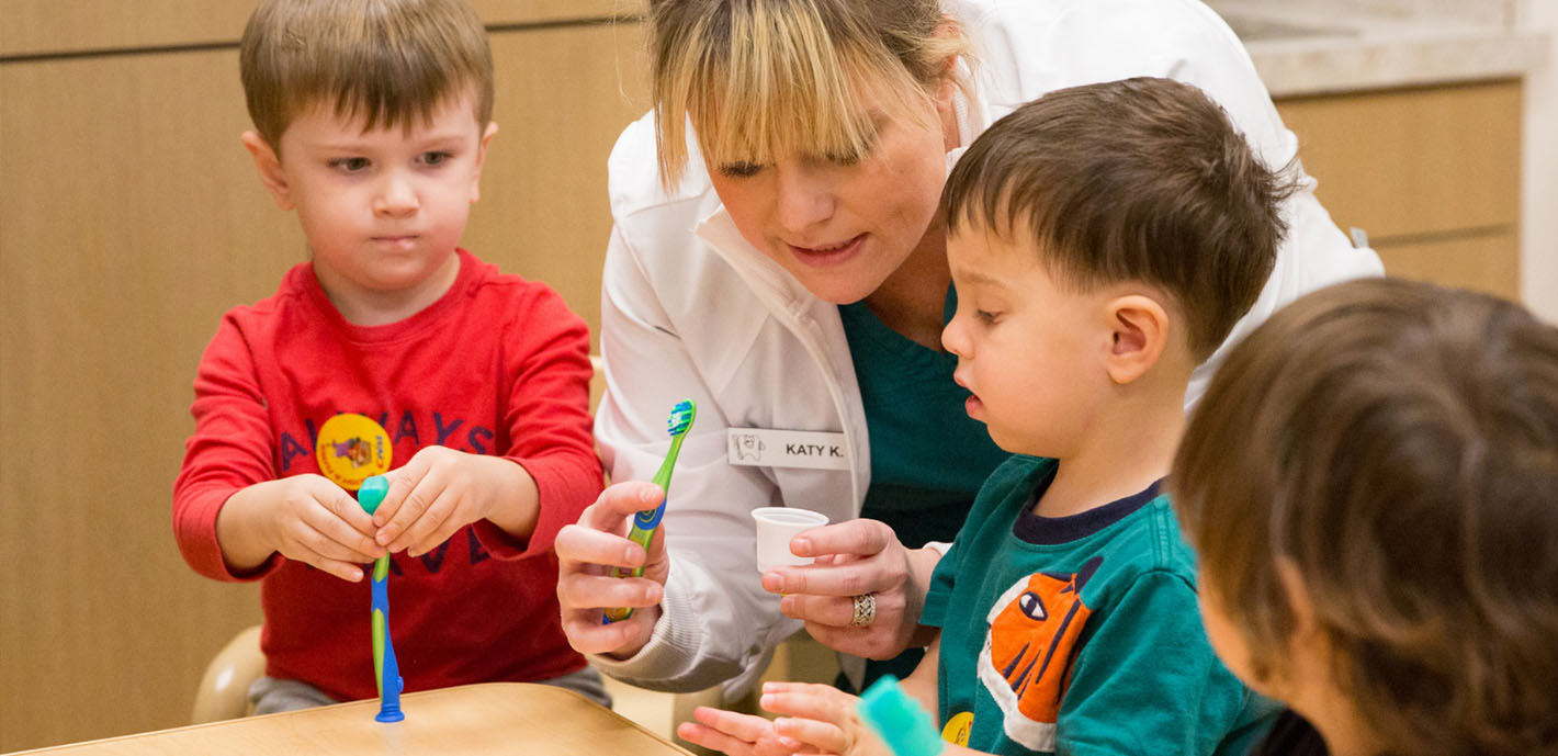 Dental students teach kids about Healthy Lion Smiles