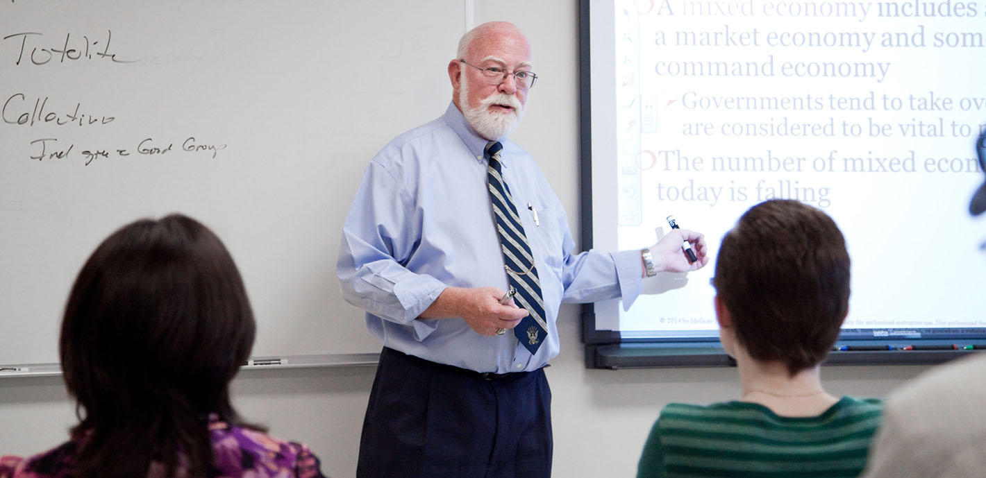 Dr. Chris Moos Honored with Excellence in Education Award